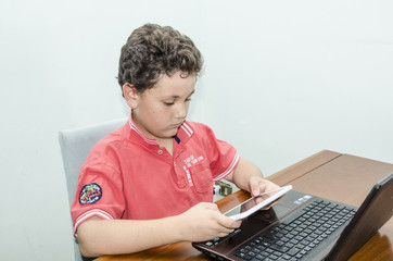 Child uses new technologies.