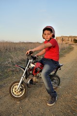 Child plays with minibikes.