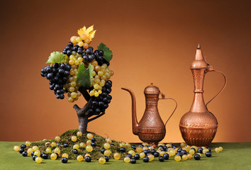 Copper carafe and fresh grapes