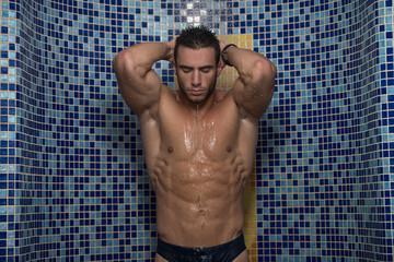 Young Sexy Man Washing In Bathroom