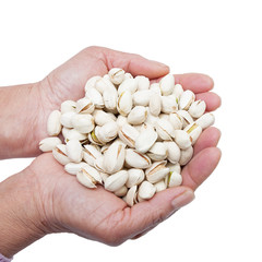 Pistachio nuts in the woman's hands