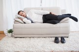 Businessman sleeping on couch after long day