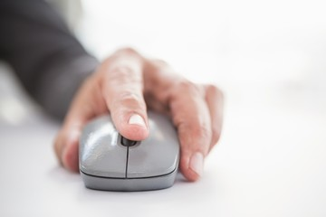 Businessmans hand on computer mouse