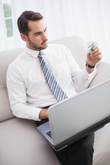 Businessman shopping online on his couch