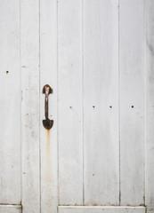 Wooden door with handle close up texture background