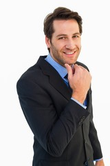 Businessman touching his chin while smiling at camera