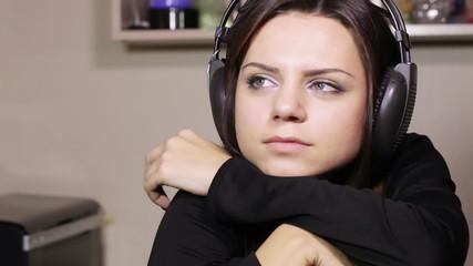 Girl with headphones near table