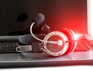 headphones on notebook keyboard