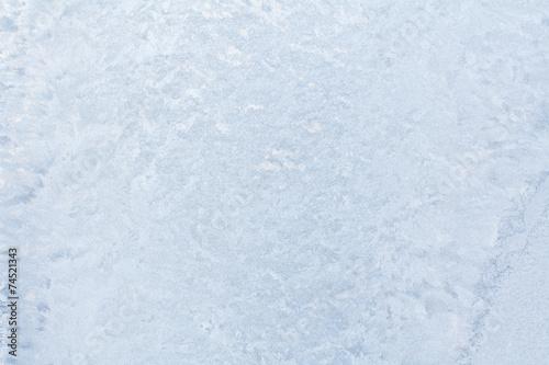 Ice patterns on winter glass. - 74521343