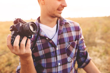Young Man with retro photo camera outdoor hipster Lifestyle
