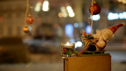 Christmas composition window. Behind the glass the night