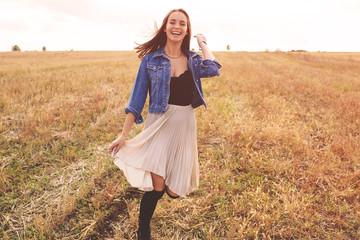 Beauty girl outdoors enjoying nature. Free happy woman