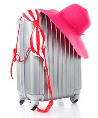 Travel suitcase, hat, swimsuit isolated on white