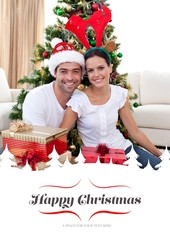 Composite image of happy couple celebrating christmas at home