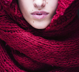 young pretty woman lips in sweater and scarf all over her face