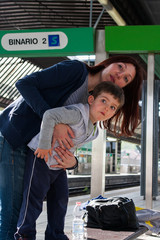 Mom and son in the train station