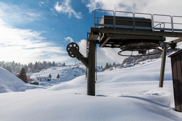 Disembarking station of chairlift ascending.