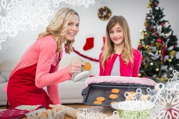 Mother and daughter making christmas cookies