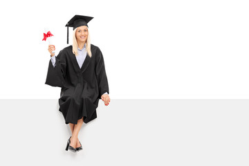 Female graduate student holding a diploma