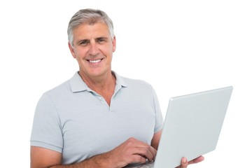 Casual man using a laptop