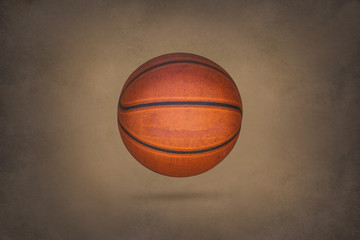 Old basketball on grunge texture background
