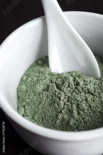 Green cosmetic clay in a bowl
