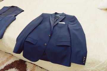 Blue Jacket on Bed