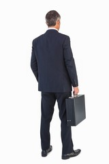 Businessman in suit holding a briefcase