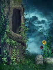 Stare drzewo z bluszczem na kolorowej łące