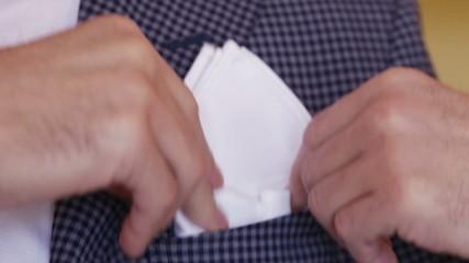 Shawl pocket of his jacket