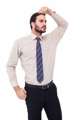 Serious businessman standing with hand on head