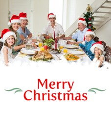 Happy family in santa hats having christmas meal