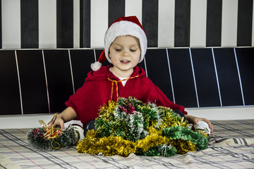 boy and Christmas decorations