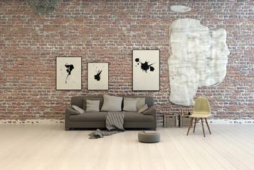 Generic grey sofa against a brick wall
