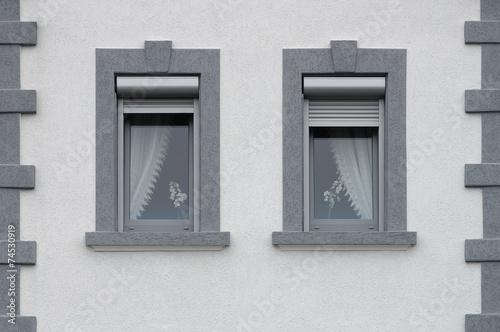 Poster Zwei graue PVC Fenster mit außen liegenden Rollladenkästen