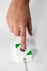 press the button with finger, on white background
