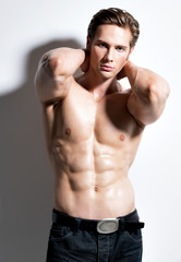 Sexy muscular young man looking at camera.