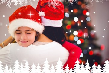 Composite image of mother and daughter hugging at christmas