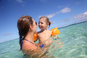 Mother and daughter swimming in Caribbean sea