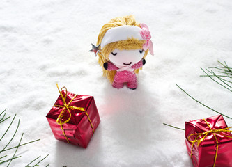 angel and gift on snow, doll hand made concept