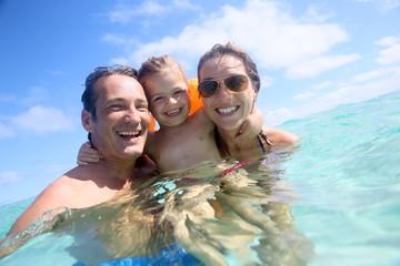 Family enjoying bathing in the sea