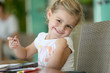 canvas print picture - Cute little girl making drawings