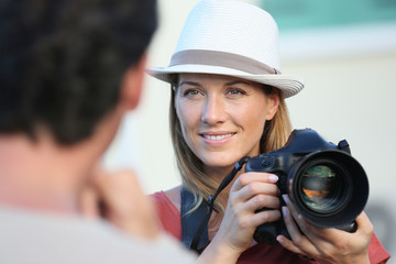 Portrait of woman photographer guiding model