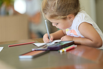 Cute little girl making drawings