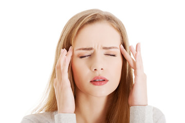 Portrait of young woman with huge headache