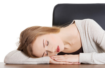 Tired woman slepping on desk