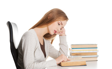 Tired woman preparing to exam