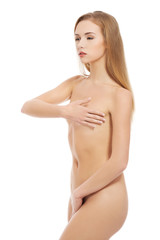 Nude woman covering her intimate places