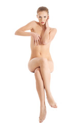 Front view nude woman sitting