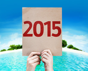 2015 card with a beach on background